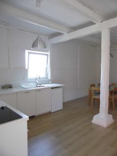 Fully fitted kitchen in the Barn End with dining area