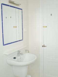 The bathroom has WC, bath, shower, basin, shaving point and wall mirror