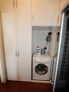 Combined washer/dryer in the utility area.