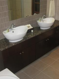 The master bathroom - with double sinks, walk in shower and a private balcony