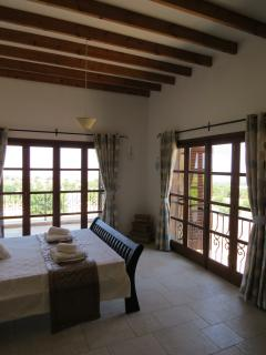 The beautiful master bedroom - with traditional Cypriot timbered beams