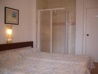 Twin bedroom with en-suite walk-in shower.  Ideal for those with limited mobility