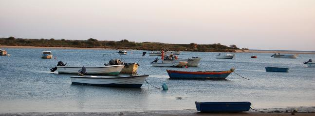 The calm and tranquility of fishing boats at nearby Cacela Velha during the hours of sunset