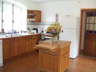 Large country style kitchen with food preparation block