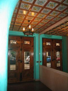 Valencian entrance hall to building with traditional hand-painted tiling and lift