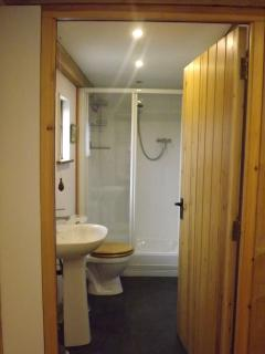 The downstairs shower room with heated towel rail.