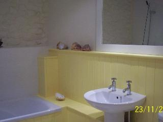 Batheroom. Has shower and heated towel rail.