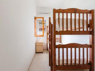 Bedroom with bunk bed and air conditioning