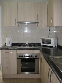 Recently updated kitchen with fridge-freezer, coffee maker and microwave.