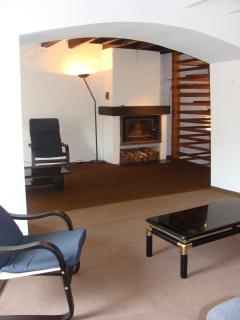 large lounge with wood burner and beams