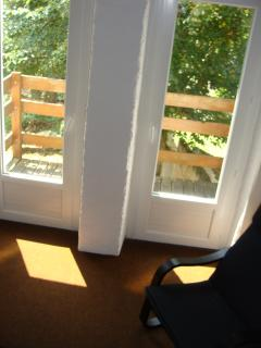 first floor balcony from the lounge with view of the pine forrest