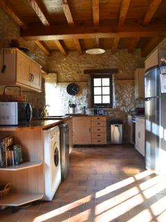 The kitchen - with microwave, dishwasher, washing machine, gas hob, electric fan oven.