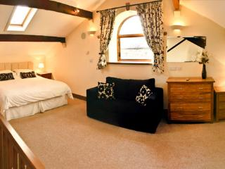First floor bedroom (23') with superking bed, single bed and sofa bed if rquired. Ensuite. TV.