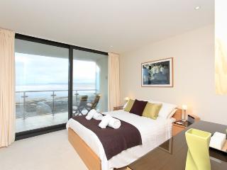 Double bedroom with floor to ceiling windows