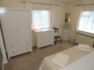 Dual aspect Blue room with free-standing wardrobe, chest of drawers and corner basin unit