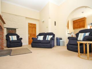 Cosy high-ceilinged sitting room