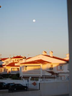 Watching the sun go down - and the moon come up - from the rooftop sun terrace
