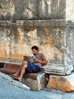 Carpet dealer taking a break by the King's tomb