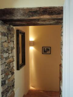 First floor landing with exposed original stone wall and chestnut beams
