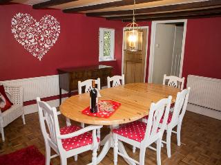 Beautiful dining room with traditional farmhouse table