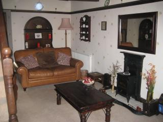 homley feeling lounge with original beamed ceiling.