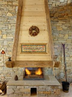 A traditional open fireplace