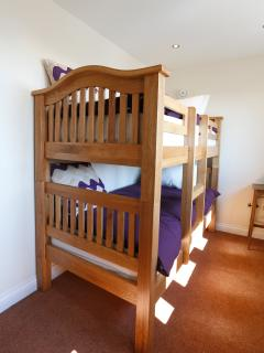 Full sized bunks each with individual adjustable reading lights