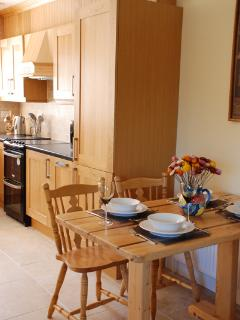 Fully fitted kitchen with dining table and chairs