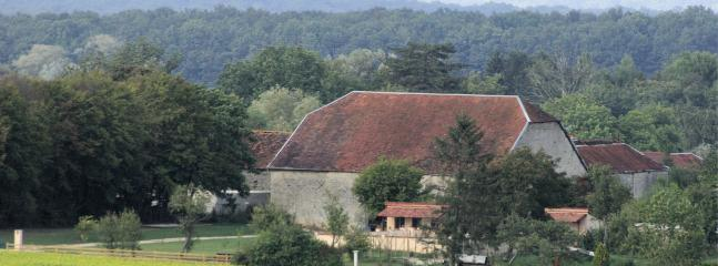 The large barn from across the fields