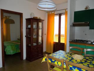 livingroom from entrance, sight of double bedroom, balcony door and kitchenette