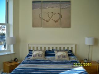 Main bedroom - with flat screen television and large wardrobe and chest of drawers