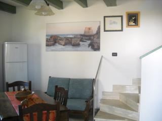 The livingroom and the stairs for the bedrooms