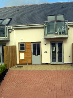 Front of the house with parking for the car