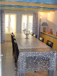 large dining room, table and chairs for up to 8 people