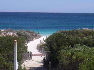 Beach front, direct beach access via 'virtual private path' to the beach viewed from the balcony.