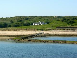Les Pourciaux House and adjoining cottage from Fort Raz Causeway