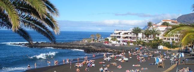Sunbathing at Playa de Arena around midday.....
