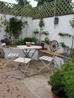 South facing rear courtyard garden, planted with herbs and flowers