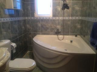 Ensuite featuring double ended bath together with over bath shower, perfect for a relaxing soak.
