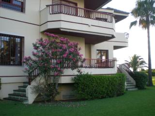 Apartment steps down to lovely garden and beach