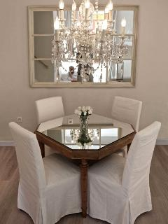 Dining set off by an exquisite chandelier