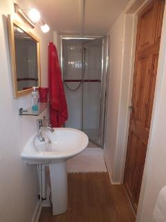 Showing, the bright and clean en suit shower room.