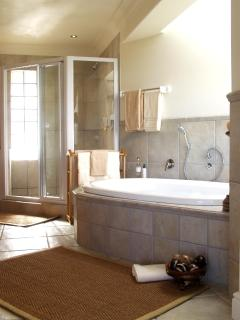 Master en-suite bath / shower room with large dressing room. The bathroom is open plan.