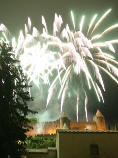 Bastille day fireworks over Carcassonne Cite. One of the best views is from Pont Vieux.