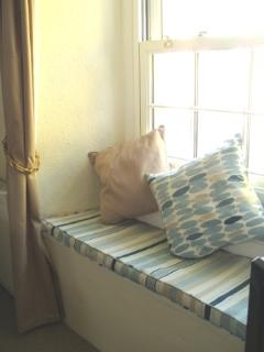 The window seat is a cosy spot to watch the horse riders go by.