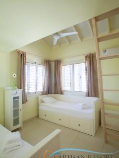 Children room with two single beds. On request, one of them can expand to become a double.