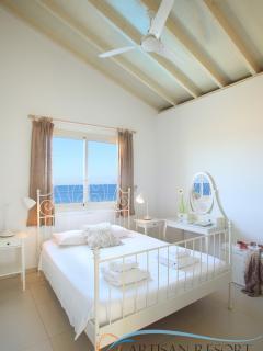 This Double-Bed room also faces directly the sea! Well lit, breezy, airy ceilings and light tones.