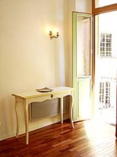 Sunny Living room with doors to balcony