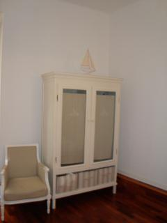 Master bedroom with armoire cupboard