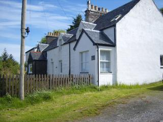 Frontage of the cottage with parking along the side